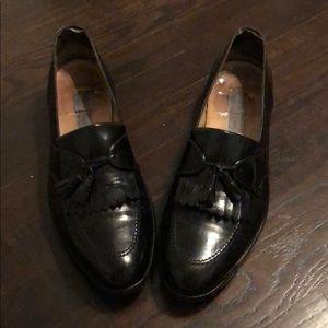 Men's black tassel dress loafers by Bruno Magli